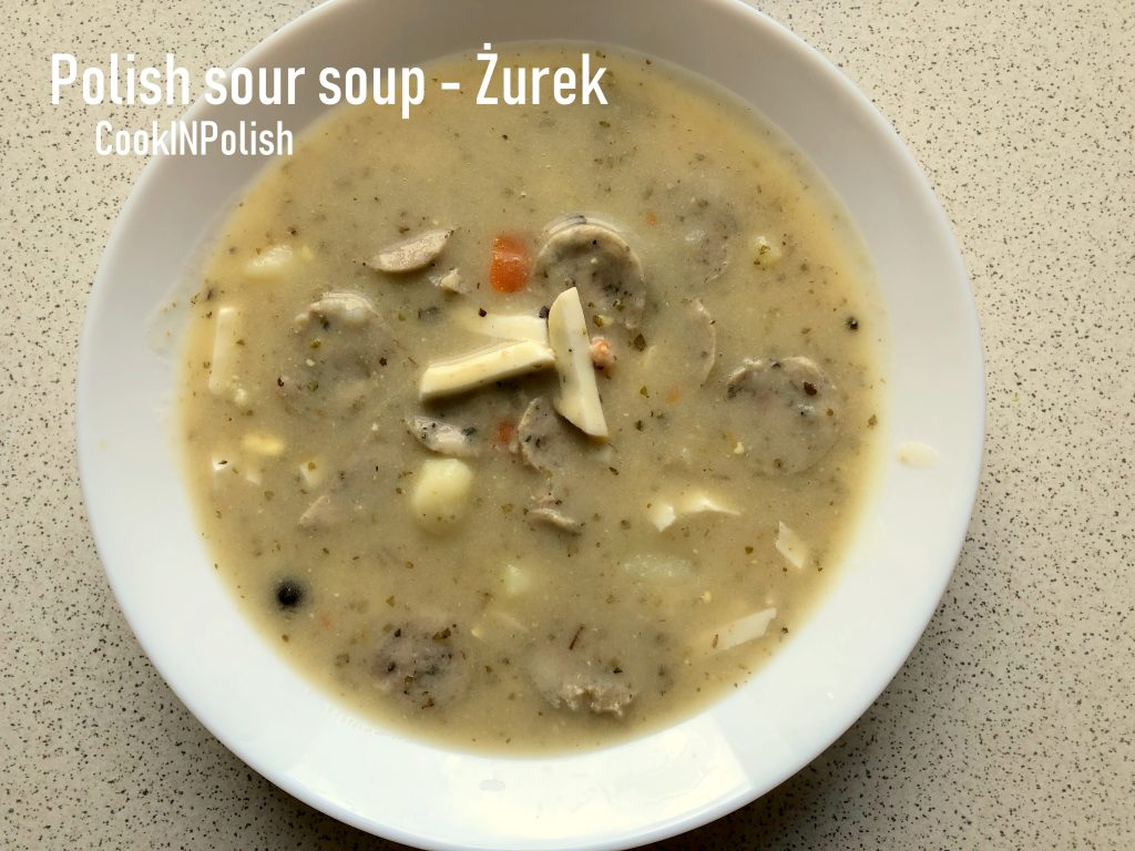 Polish Sour Soup Żurek served on the plate.