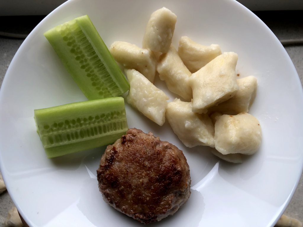 Polish Kotlety Mielone served with kopytka and cucumber