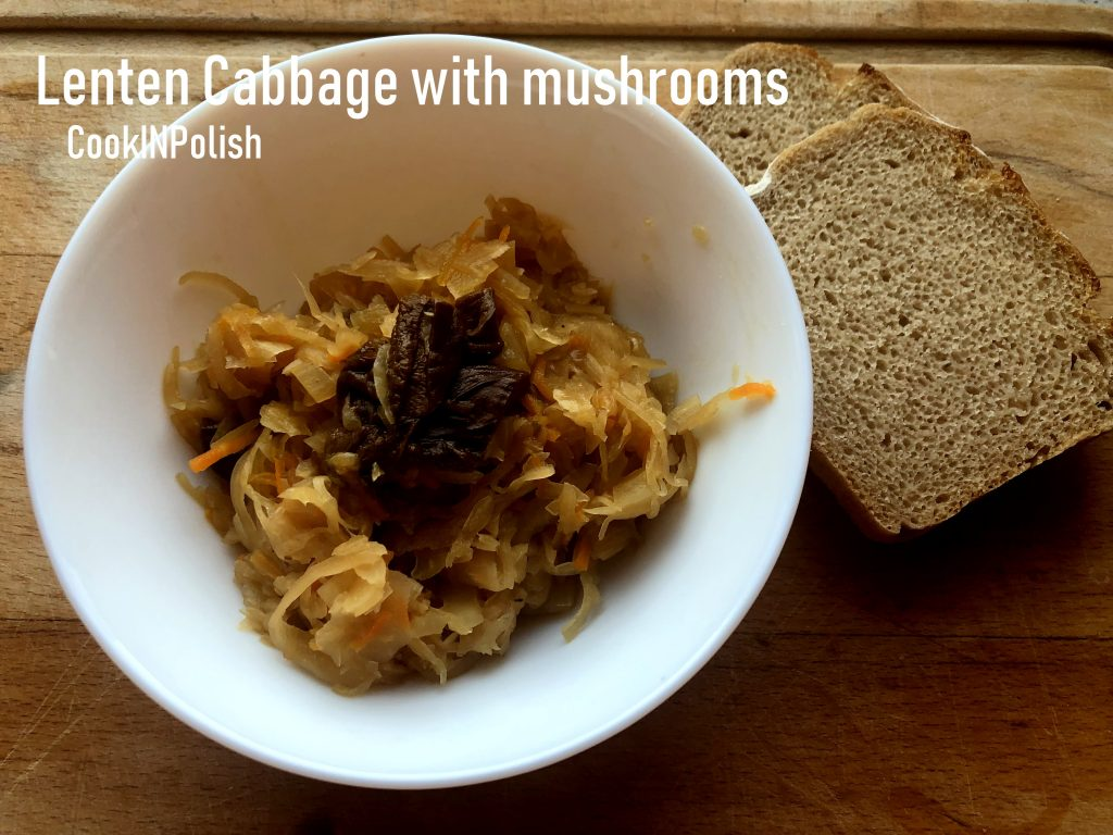 Lenten cabbage with forest mushrooms served on the plate with rye bread.
