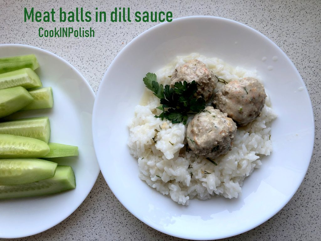 Meat balls in dill sauce served on the plate with rice