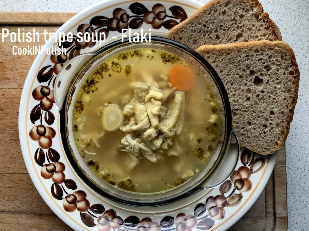 Polish Tripe Soup Flaki, served on the plate with rye bread.