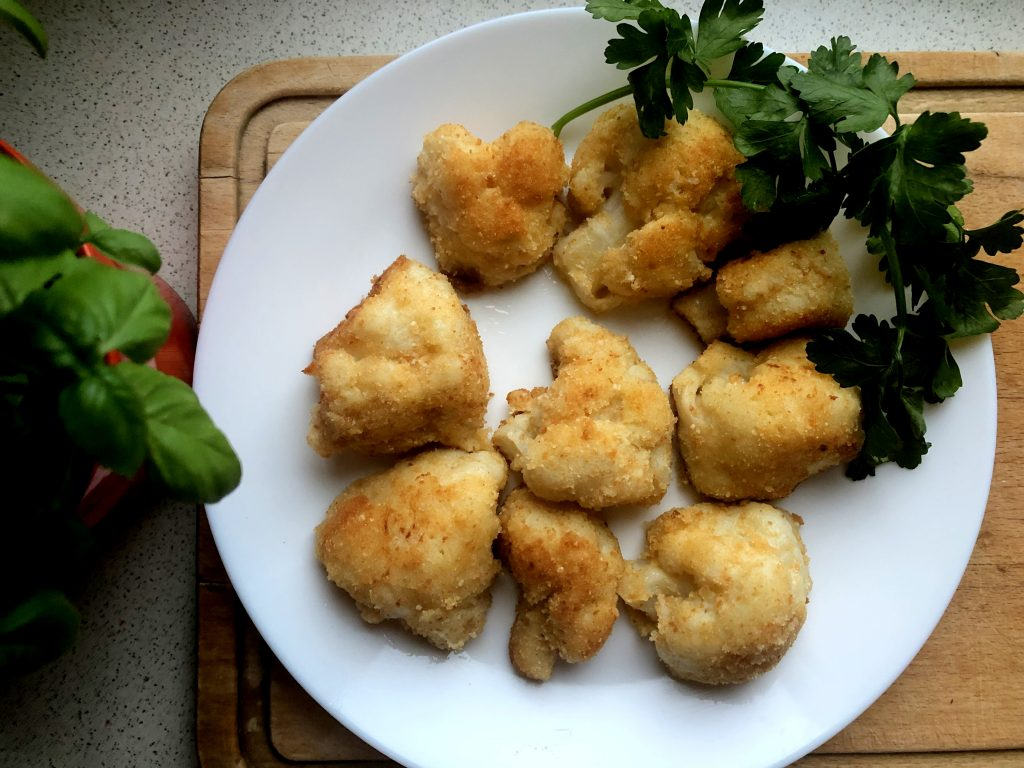 Fried cauliflower served on the plate with parsley greens.