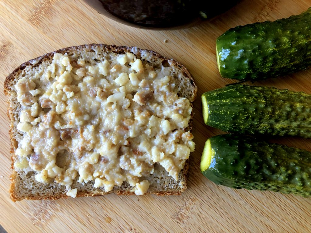 Smalczyk on the rye bread served with Małosolne cucumbers