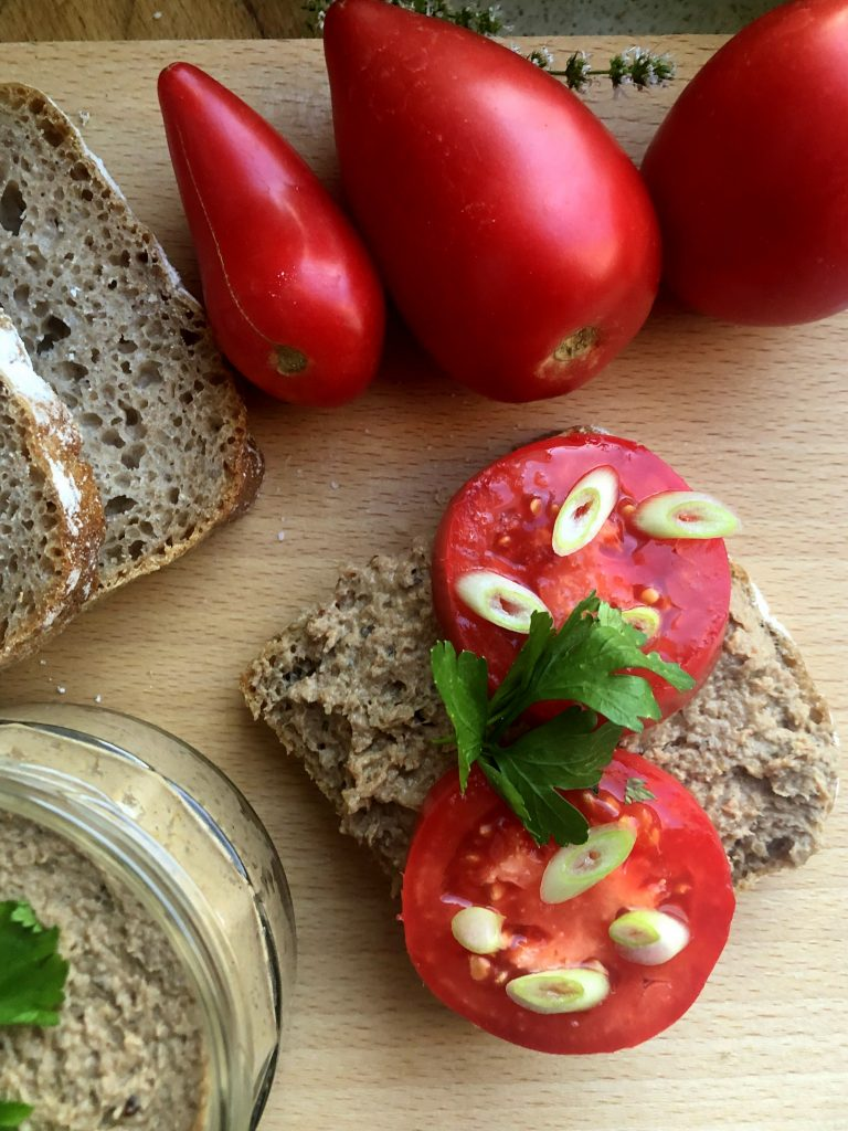 Bread with No baking turkey pate served on rye bread with tomato.
