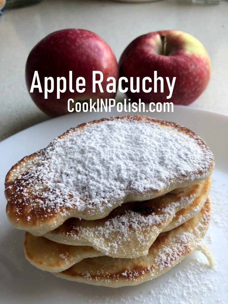 Apple racuchy served with powdered sugar and apples.