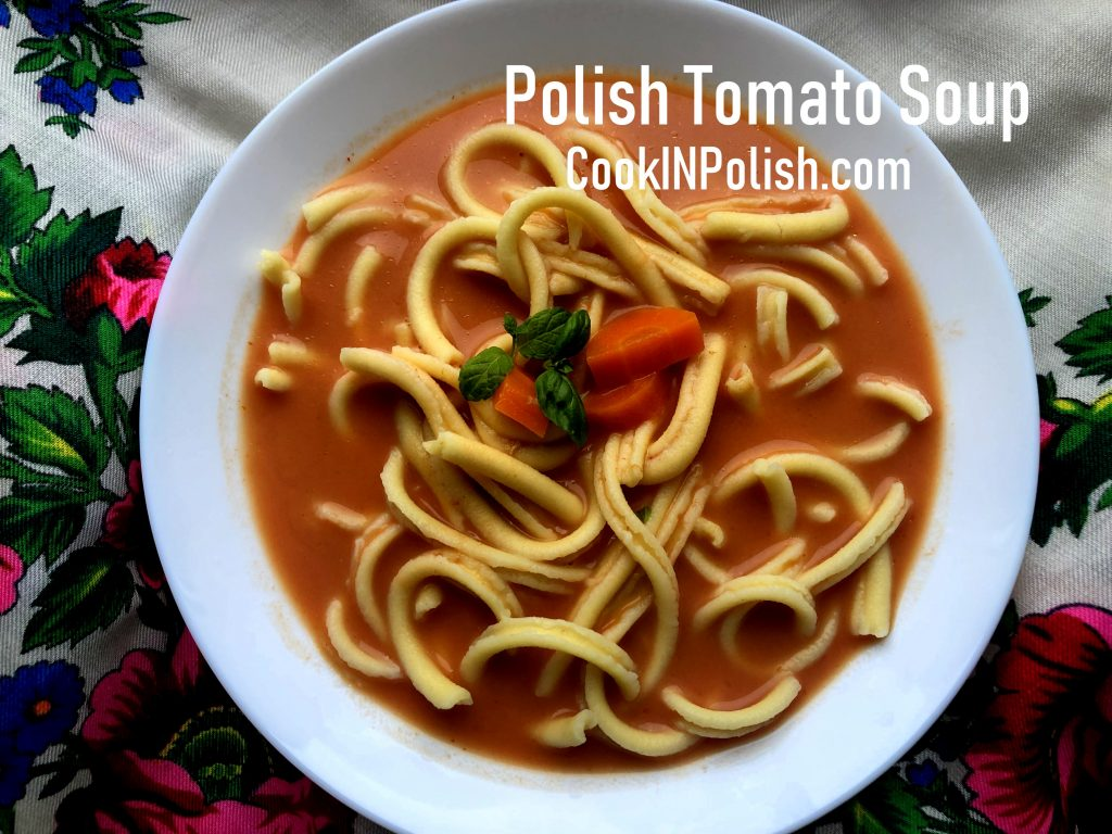 Polish tomato soup served on the plate with pasta
