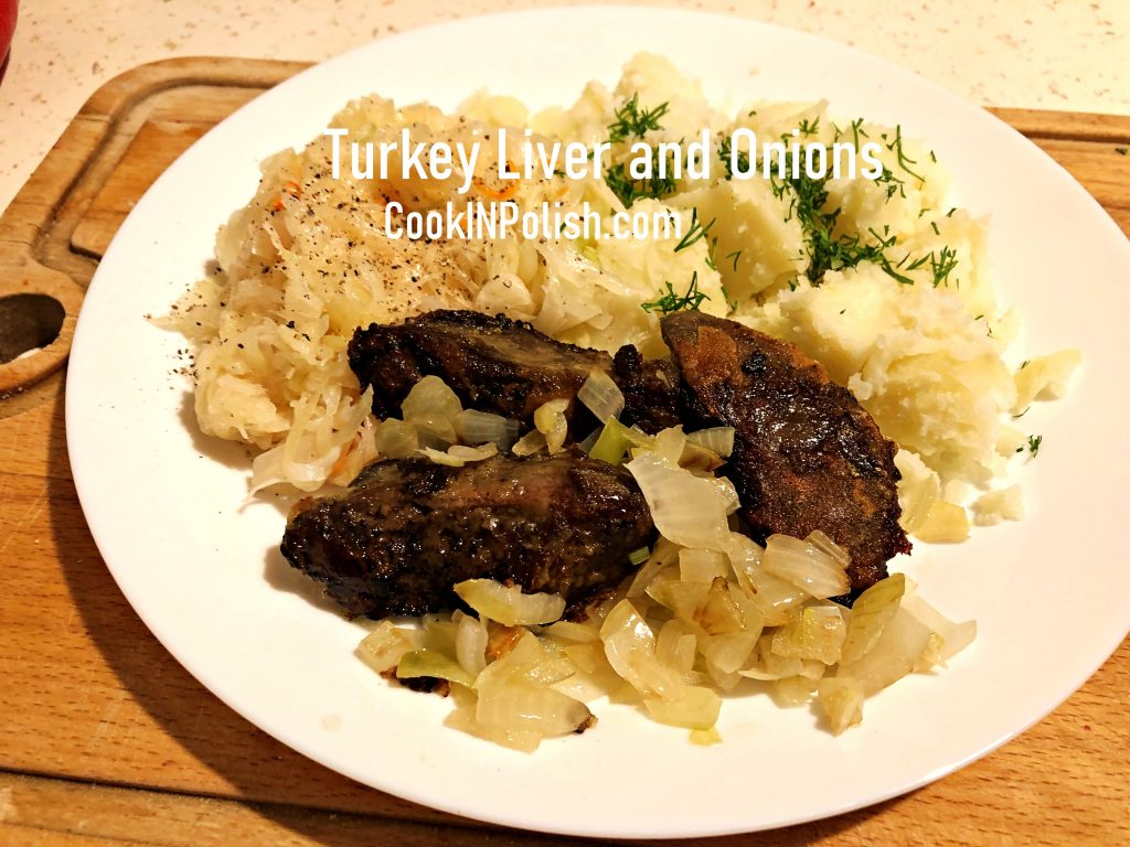 Turkey liver and onions served on the plate.