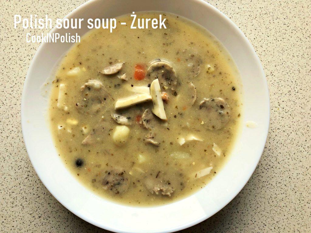 Traditional Polish Soup: Żurek Polish rye soup served on a plate.